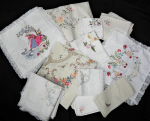 Lot 9 - Group lot of vintage Napery including, white and ecru embroidered tablecloths, doilies, cushion covers - assorted designs and sizes - approx 52 pieces