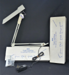 Lot 59 - Pair of Luxo Task Fluro Lights, white, unopened in their original boxes, with desk mounting clamps