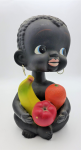 Lot 100 - Large 1950s black Bobbing head ceramic Boy money box - seated with fruit in lap - approx 27cms H - small chip to back of head