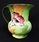 Lot 110 - 1930s H & K Tunstall English ceramic Jug - Floral decoration on a light green ground, marked to base - 14cm H