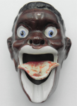 Lot 129 - Novelty porcelain  Ashtray - face looking up with flipping tongue and holes in nostril - marked to base 'patent TT' - 9cms L