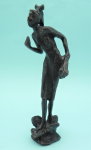 Lot 137 - Heavy Bronze Sculpture - Figure of stylised female holding flowers, signed but illegible & dated 96 to base - 20cms H