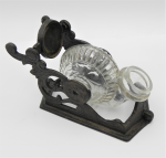Lot 138 - 19th C  Cast Iron ink stand with  glass Snail bottle that revolves and tilts