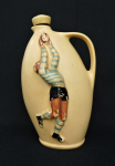 Lot 155 - 1950s Diana Geelong Footballer flask - cream ground with embossed footballer taking a mark - sgd to base - approx 23cms H