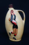 Lot 156 - 1950s Diana St Kilda Footballer flask - cream ground with embossed footballer taking a mark - sgd to base - approx 23cms H- has fine lacquer coating t