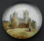 Lot 180 - c1900 glass paperweight featuring coloured scene of Canterbury Cathedral - 5 cms D