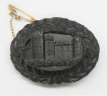 Lot 181 - Carved oval Victorian bog oak Brooch - featuring Abbey scene surrounded by wreath - 5cms D