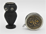 Lot 182 - 2 x Owl novelty Sewing items - Bogwood owl shaped Thimble holder with thimble & small tape measure with embossed owl face with glass eyes to top
