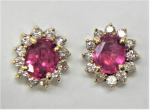 Lot 193 - Pair of 14ct gold  oval RUBY halo stud earrings each surrounded by 12 small diamonds - ruby approx 1ct each - TW 2 8 grms marked 585
