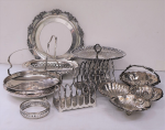 Lot 53 - Group lot Silverplate Serving items inc 2 x Toast racks, Pedestal Cake Plate, 3 sectioned tray, handled baskets etc