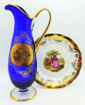 Lot 68 - 2 x Vintage items Limoges style large cabinet plate with centre courting scene 25cm D  & Tall blue & gilt Jug with courting scene to front 35cm