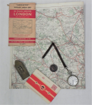 Lot 69 - Group lot - 1797 British copper Penny, brass paper Clip, Waltham pocket watch (af), cloth folding map of 20 miles around London & packet unused Britis
