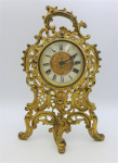 Lot 83 - c1900 Brass Mantel Clock Case, Enamel Roman Numerals with central detailing, original winding movement replaced with Quartz, working - 27cm H