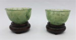 Lot 124 - Pair small translucent  and solid Chinese green Jadeite bowls - 4cms D 3cms H with wooden stands