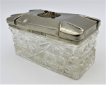 Lot 126 - 1930s Art Deco oblong box with metal lid and circular inset owl with glass eyes 5 x 10 x 5cm
