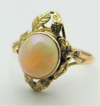 Lot 194 - Ladies 9ct ygold ring -  round cabochon white opal in floral setting - TW 2 4 grms